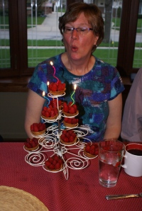 Nana blowing out the candles of her raspberry tarts