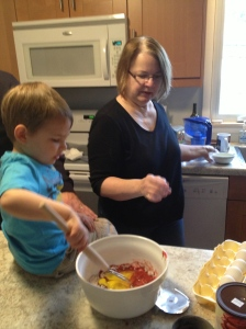 Jamie helping Grandma mix up Red Velvet pancakes!